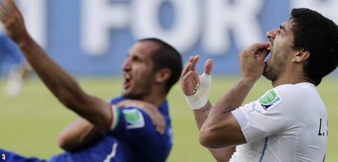 Uruguay's Luis Suarez bit Italy's Giorgio Chiellini during their World Cup group game. Photo taken from BBC