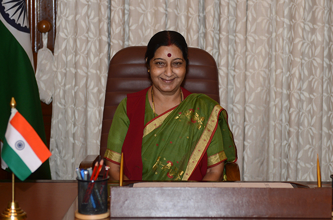 India's newly appointed Minister of External Affairs Sushma Swaraj poses after arriving for her first day at office in New Delhi on May 28, 2014. New Indian Prime Minister Narendra Modi announced his cabinet May 27, combining several portfolios to cut the number of government positions and giving many regional politicians their first national experience. Photo: AFP/Getty Images