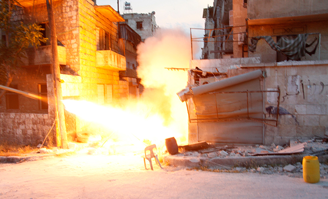 Islamist fighters fire a rocket towards forces loyal to Syria's President Bashar al-Assad in the Seif El Dawla neighbourhood in Aleppo on Thursday. Photo: Reuters