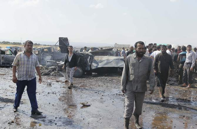 Men inspect the damage at a fuel market hit by a car bomb in the Maarat Al-Naasan area of Idlib in Syria May 28, 2014. More than 10 people were killed in the attack, according to activists. Photo: Reuters