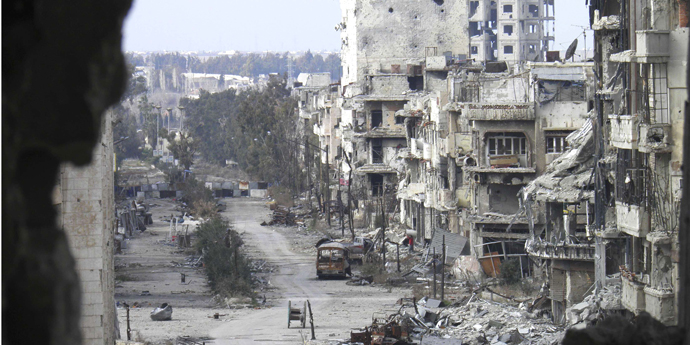 Damaged buildings line a deserted street in the besieged area of Homs January 9, 2014.