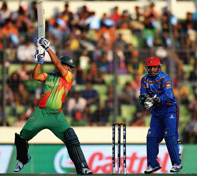 Bangladesh opener tamim Iqbal hits a boundary to his way to 21 in his comeback match after a neck injury against Afghanistan at Mirpur Sunday. Photo: ICC