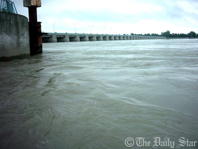 Sources at the Water Development Board, Dinajpur, say all the 44 sluice gates of the Teesta barrage have been kept open to cope with the situation. Photo: Star