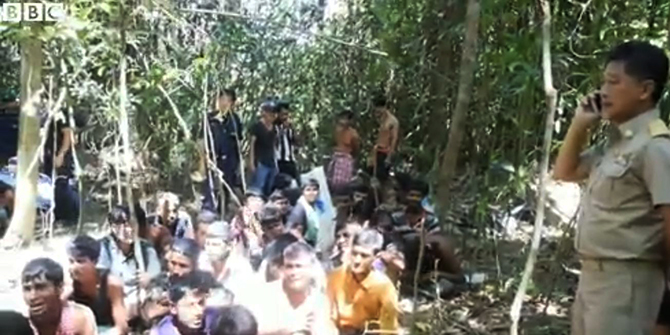 Thailand police arrest a group of Bangladeshi nationals at a rubber plantaion of the country's southern part on October 11. The arrestees were trafficked into the country illegally. Photo grabbed from BBC video