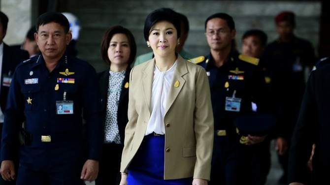 PM Yingluck Shinawatra is under intense pressure to step down and make way for an interim government. The photo is taken from BBC website.