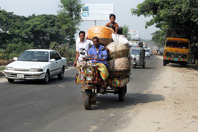 A Nasiman, locally made three-wheeler vehicle, plies a road carrying goods and people in the country. Star file photo