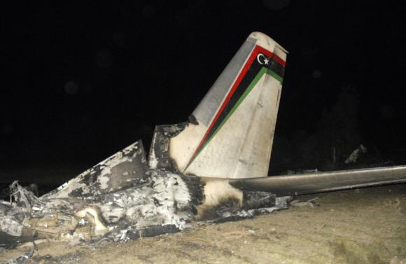 The wreckage of a Libyan military plane is seen in Grombalia town, south of Tunis, February 21, 2014. Photo: Reuters