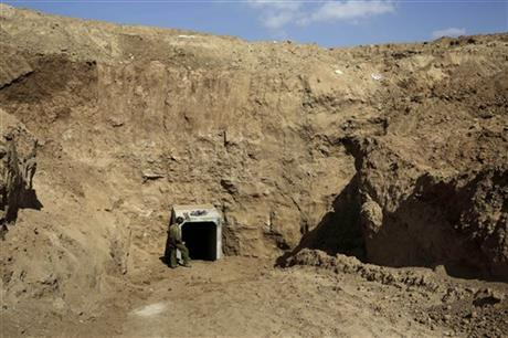 In this October 13, 2013 file photo, an Israeli soldier stands at the exit of a tunnel discovered near the Israel Gaza border. Photo: AP