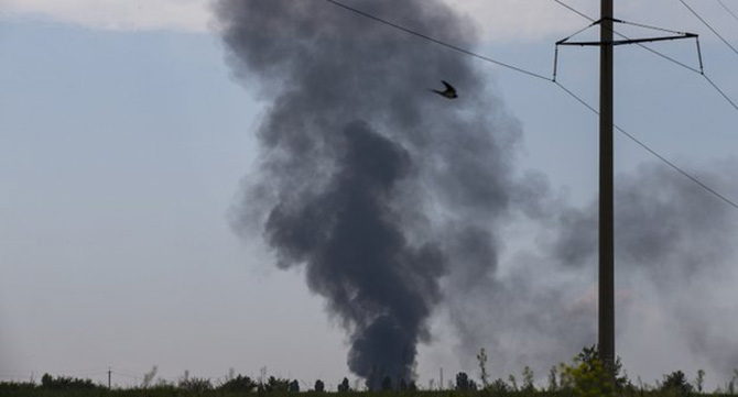 Helicopter crash scene Black smoke was seen rising from the scene of the crash. Photo: AP