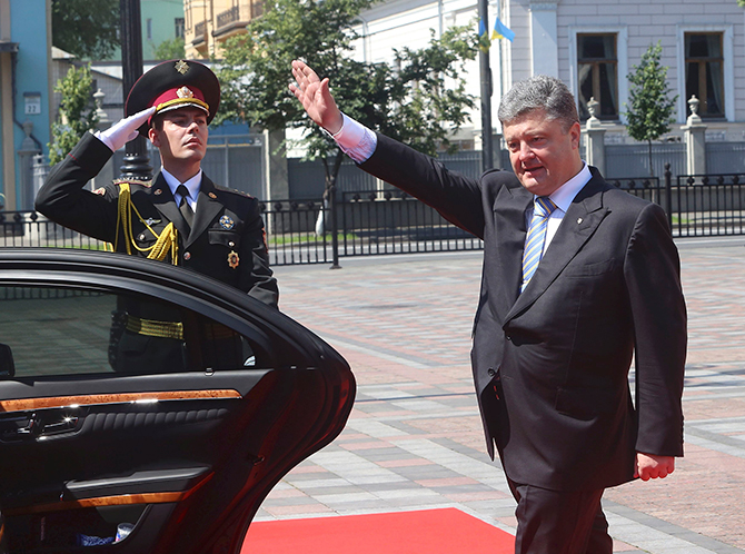 Ukraine's new president Petro Poroshenko waves as he leaves his inauguration ceremony in Kiev on Saturday.  Poroshenko took the oath today as Ukraine's president, buoyed by Western support but facing an immediate crisis in relations with Russia as a separatist uprising seethes in the east of his country. Photo: Reuters