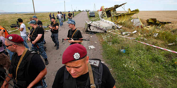 Armed pro-Russian separatists stand guard at a crash site of Malaysia Airlines Flight MH17, near the village of Hrabove, Donetsk region July 20, 2014. Photo: Reuters