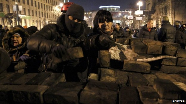 Demonstrators continued to build barricades in central Kiev