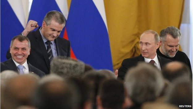 Crimea's head of government celebrated as the signing was completed. Photo: Reuters