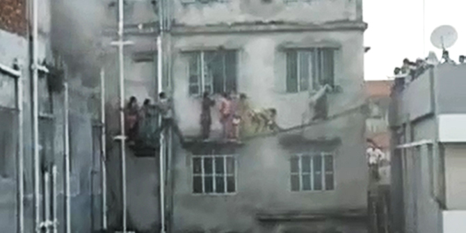 This grabbed photo of a video shows the trapped garment workers of Cordial Design Ltd are rescued by locals after the factory's third flood caught fire on Sunday afternoon. A youth named Sabbir Ahmed recorded the video during the incident.