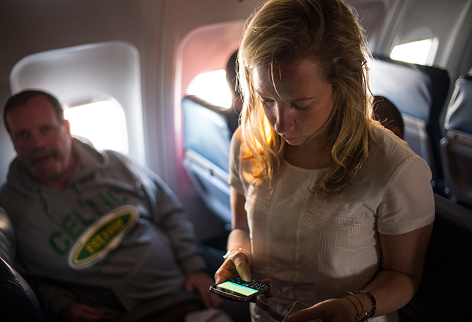 A Delta Air Line passenger uses her Blackberry as passengers wait to disembark June 6, 2014 after a flight from New York to Denver, Colorado. Photo: Getty Images