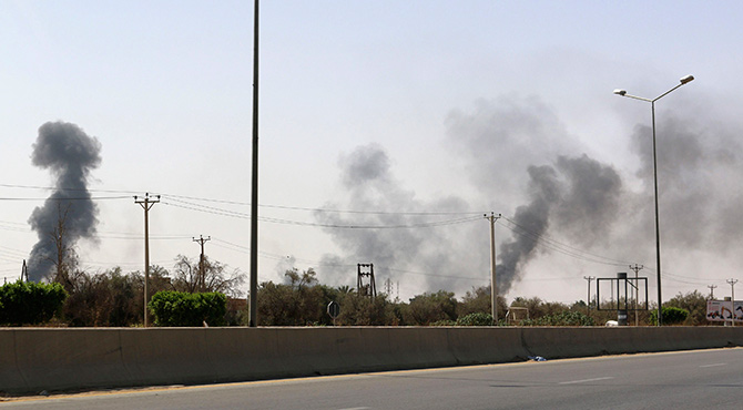Smoke rises over the Airport Road area after heavy fighting between rival militias broke out near the airport in Tripoli July 25. Photo: Reuters