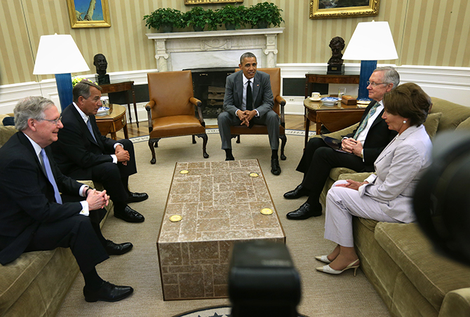 US President Barack Obama (C) meets with, (L-R) Senate Minority Leader Sen. Mitch McConnell, Speaker of the House Rep. John Boehner, Senate Majority Leader Sen. Harry Reid and House Minority Leader Rep. Nancy Pelosi in the Oval Office of the White House June 18, 2014 in Washington, DC. Photo: Getty Images