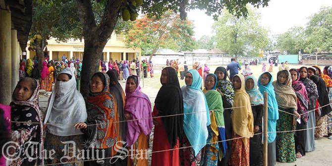 Female voters queue up for casting their votes at Haragachh Government Primary School polling centre in Kaunia upazila of Rangpur on Monday morning. The voting has begun around 8:00am in 12 upazila parishads of eight districts of the country. Photo: Star