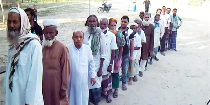 Voters are seen standing in a queue at Kalia Government Primary School polling centre in Basail Upazila of Tangail Saturday morning. The voting in Tangail-8 constituency has begun around 8:00am. Photo: Star