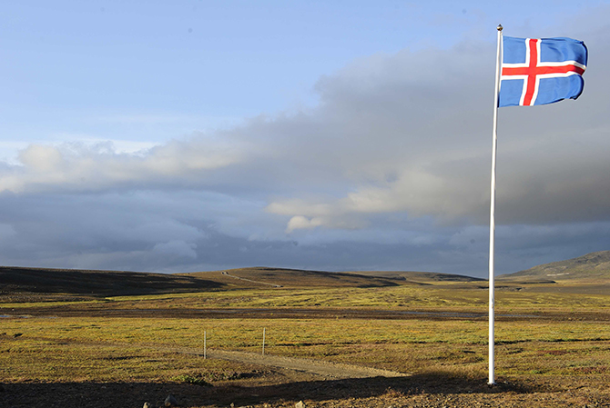 An Icelandic flag flutters in the wind in Myji Dalur August 20, 2014, the closest inhabited area to Bardarbunga volcano in the north-west region of the Vatnajokull glacier. The threat of an eruption of Iceland's Bardarbunga volcano has increased, according to the Icelandic Meteorological Office, with 'intense seismic activity' and 'ongoing magma movement' reported at the site of the volcano. Photo: Reuters