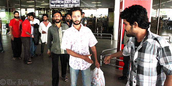 Bangladeshi migrant workers, who were reportedly deported by the Omani authorities, arrive at Hazrat Shahjalal International Airport Friday morning. Photo: Palash Khan