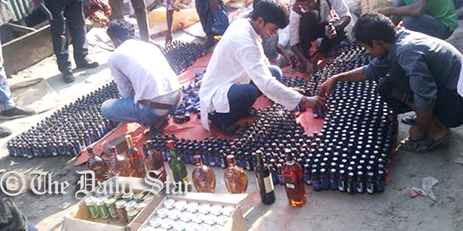 Police seize the Phensedyl, foreign liquor, beer, yaba tablets and several sharp weapons Friday from five shops of Nur Hossain, the prime accused of Narayanganj panel mayor Nazrul Islam killing. Photo: Star