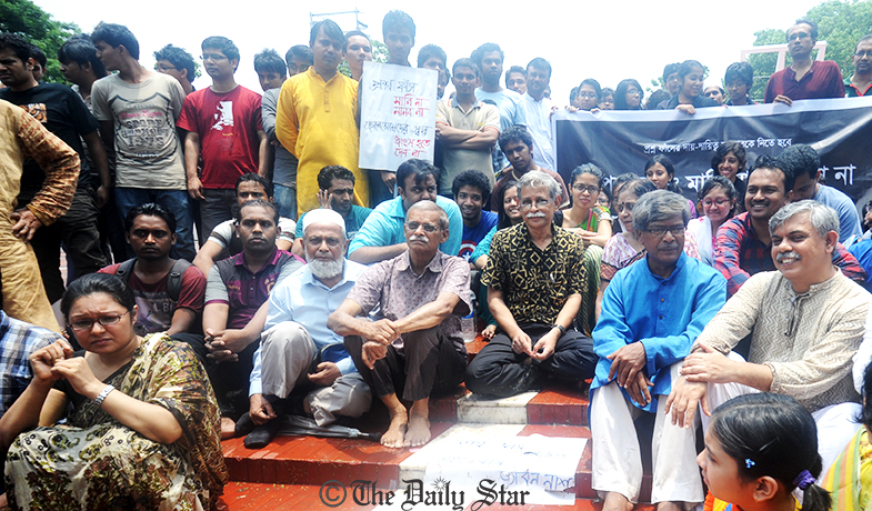 Noted author Prof Muhammad Zafar Iqbal (middle) and other renowned persons take part in a sit-in at the Central Shaheed Minar in the capital on Friday protesting the recent rise of question paper leak. Photo: Firoz Khan