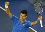 Djokovic masters Raonic to reach Australian Open semis