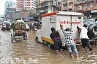 Heavy downpour drenches Dhaka