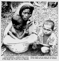 Photograph: A mother and her children at West Bengal refugee camp